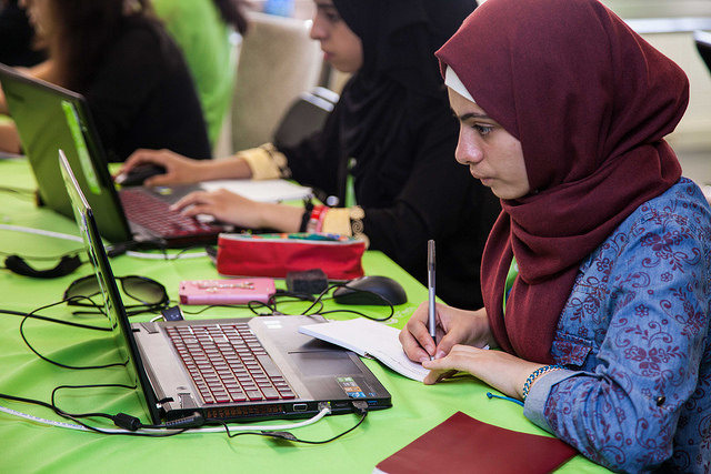 Muslim girl looking at laptop