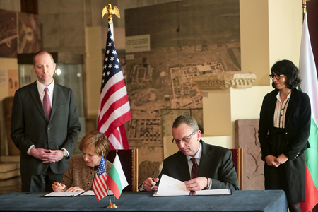 ambassador signing the MOU