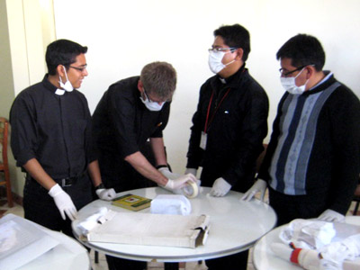 Workshop participants in Arequipa, Peru, learn how to handle and inventory cultural objects in their Colonial period churches
