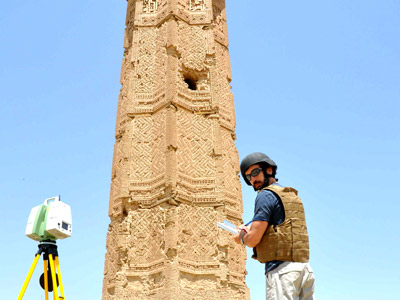 An architect with HABS, records field notes in front of the Mas'ud III tower.