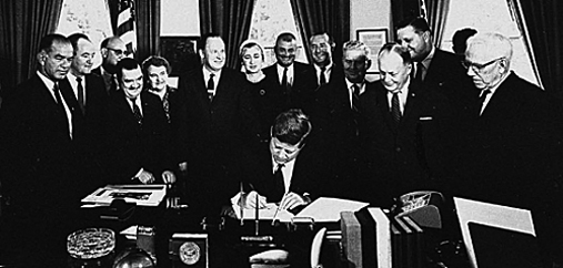 The Fulbright-Hays legislation was enacted by the 87th U.S. Congress on September 21, 1961. Here, President John F. Kennedy signs the bill into law while Sen. Fulbright (left) and others look on.