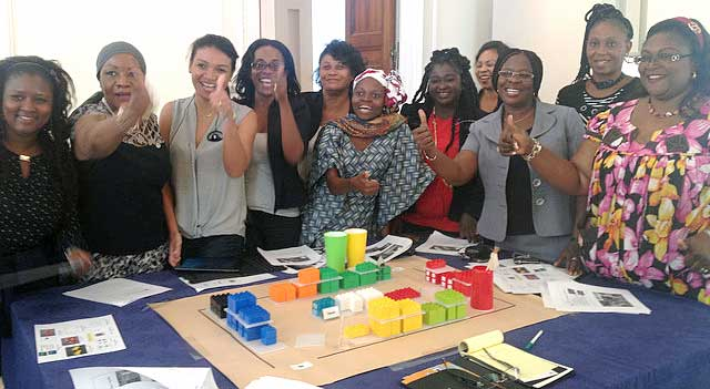 The women visitors working on Lego project