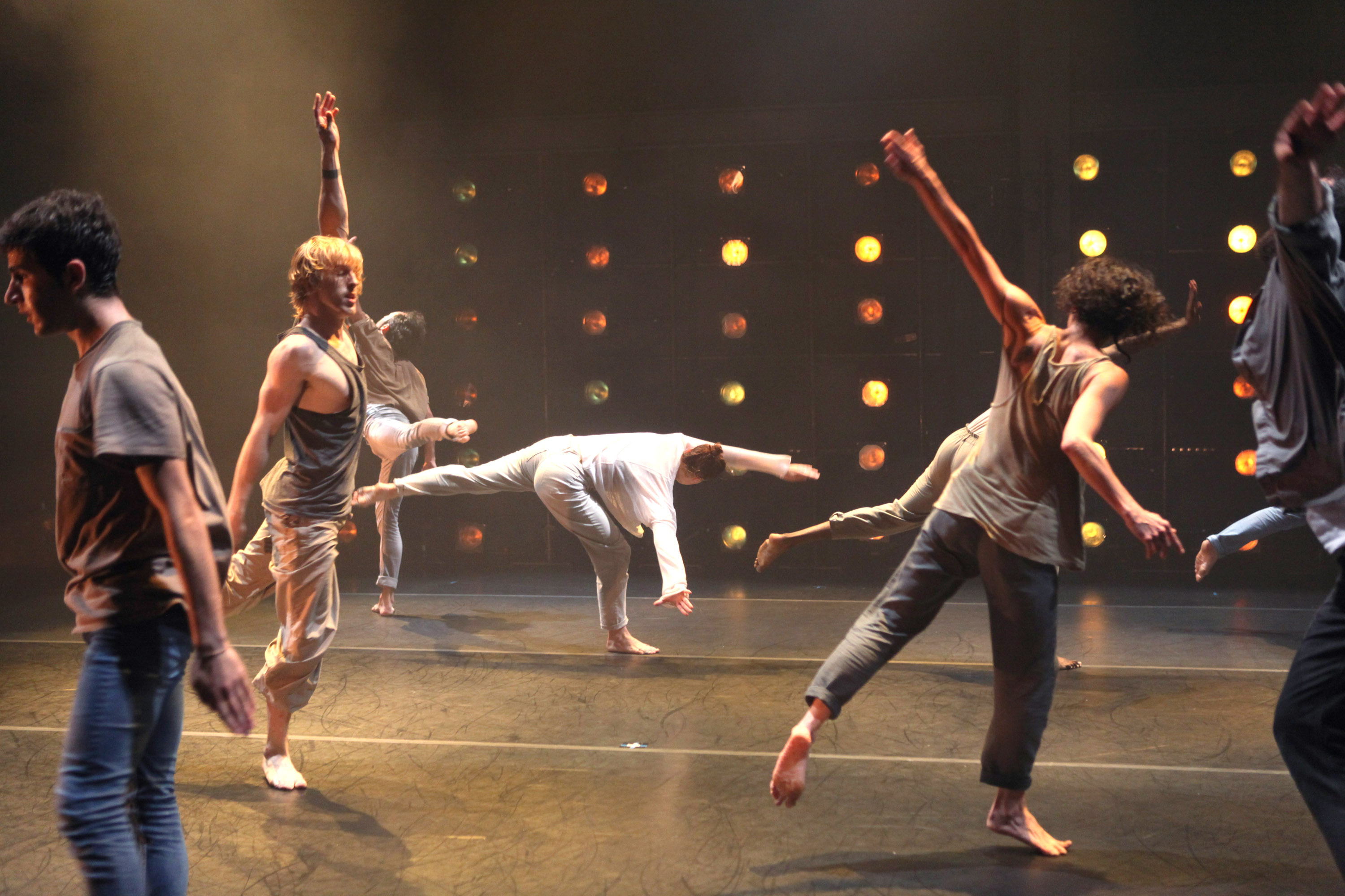 Dancer jumping and dancing in different directions on stage