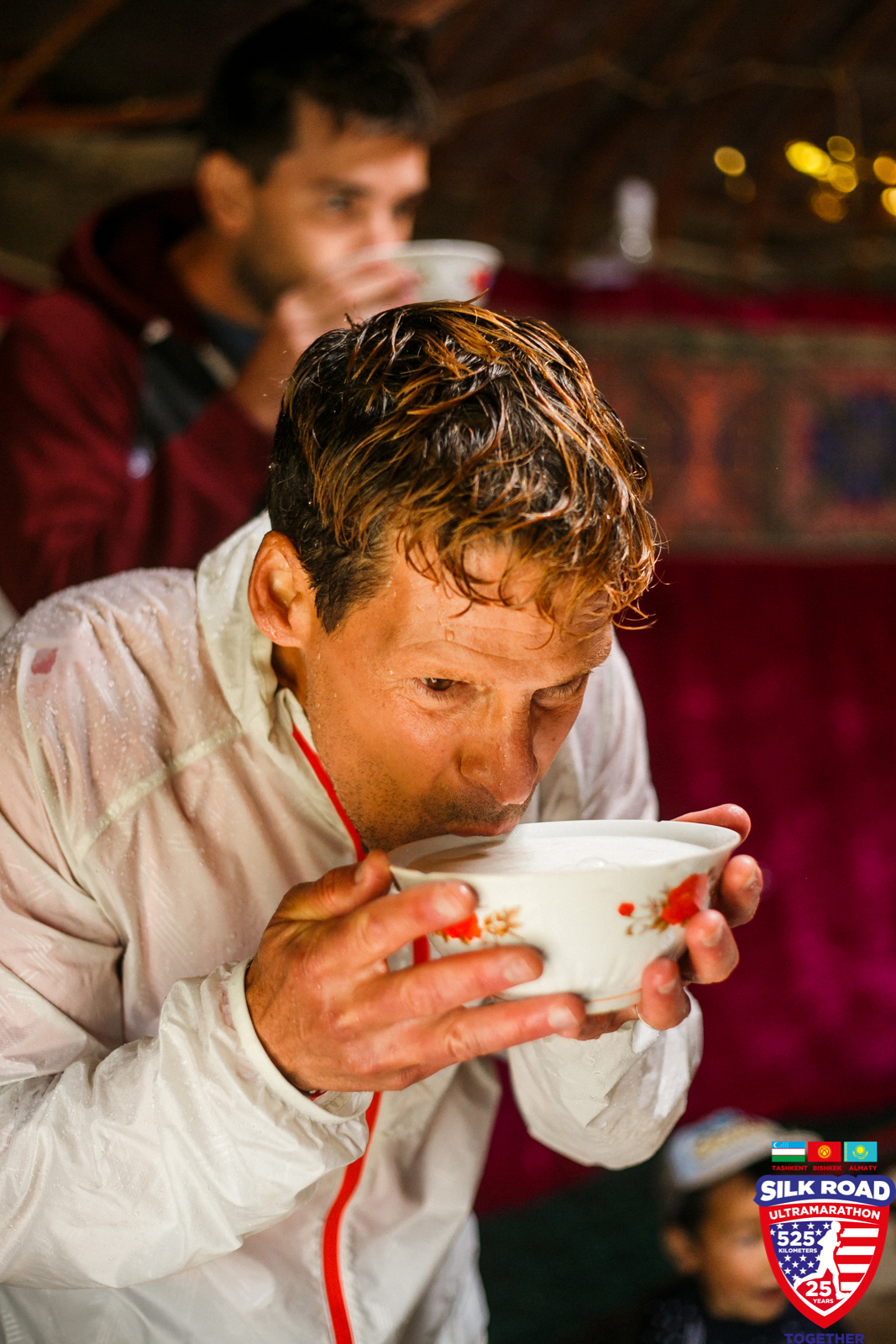 Dean drinking kumis or fermented horse milk, a Kyrgyz staple