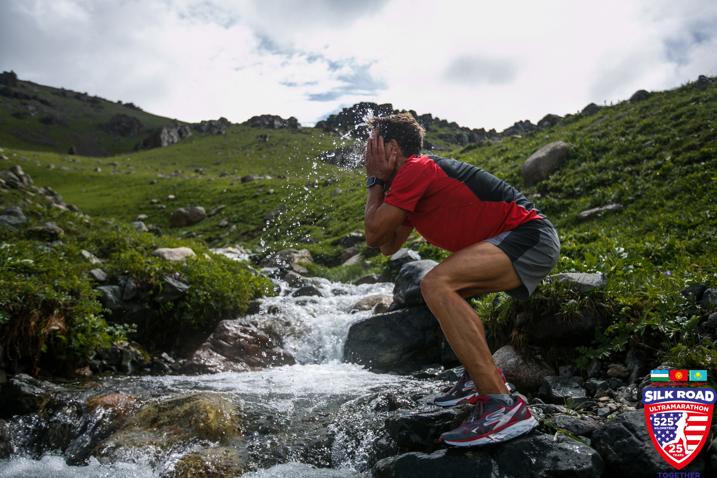 Dean cools off by splashing his face with water from a mountain stream