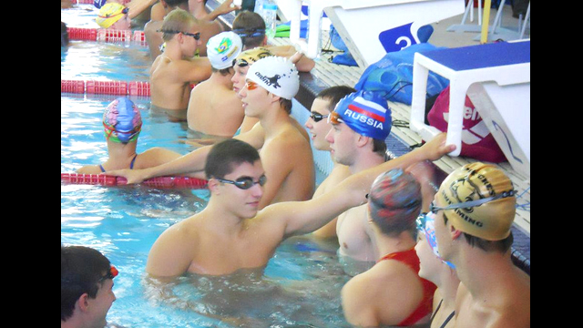 Despite their different backgrounds and homes, the swimmers communicate well during practice.