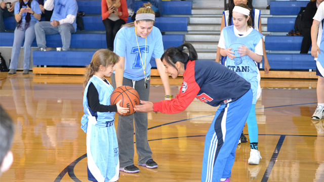 The players take part in a games and skills practice with Special Olympic athletes.