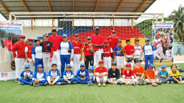 Group shot before a baseball clinic with Sports Envoys Barry Larkin and Joe Logan in Ecuador.