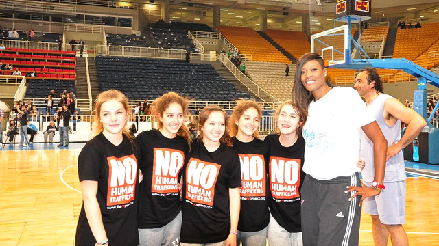 "WNBA Washington Mystics Player Ashley Robinson meets high school students at the ""Break the Chain of Human Trafficking"" all-star event."