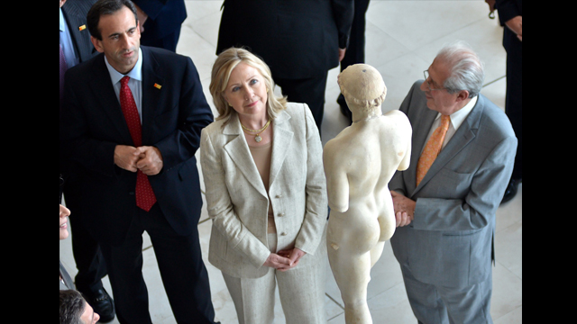 "U.S. Secretary of State, Hillary Clinton, admiring the sculpture ""Kritios Boy"" at the Acropolis Museum."
