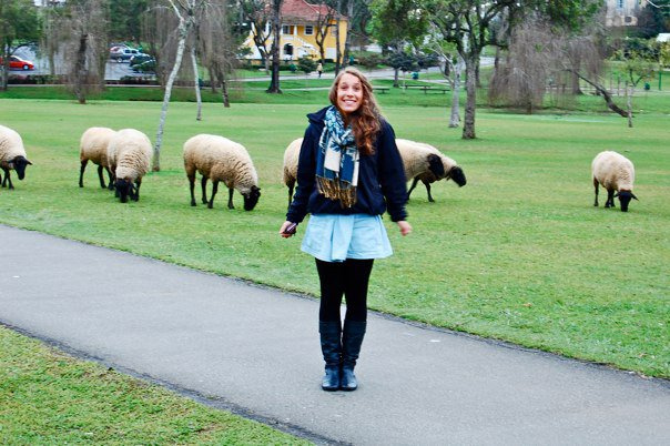 Mia, U.S. Youth Ambassador discovers sheep at a local public park in Curitiba, Paraná, Brazil in August 2010.