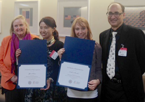 Participants pose with their certificates for completing the program