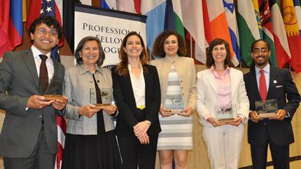 Spring 2014 Alumni Impact Award winners (L-R) Ahmadhon Yusupkhanov, Germaine White, Nadia Rabaa, Rachel Havrelock, and Lavell Kirby pose with ECA Assistant Secretary of State Evan Ryan (third from left).