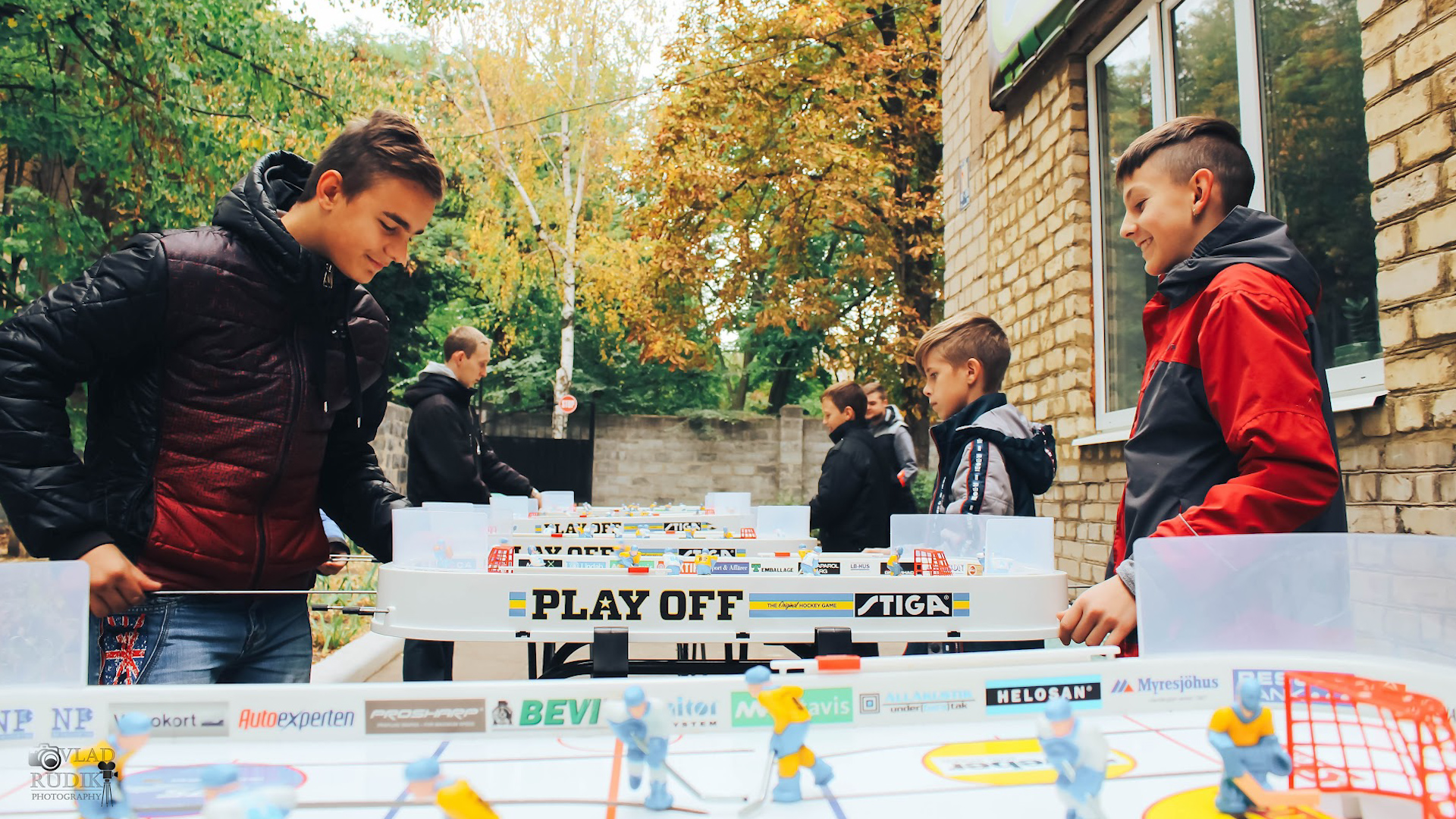 Two kids playing table hockey