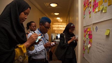 Mandela Washington Fellows brainstorming at the feedback wall.
