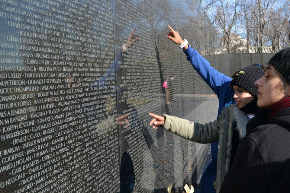 During their tour of Washington, D.C., the group takes time to absorb the significance of the Vietnam War Monument.