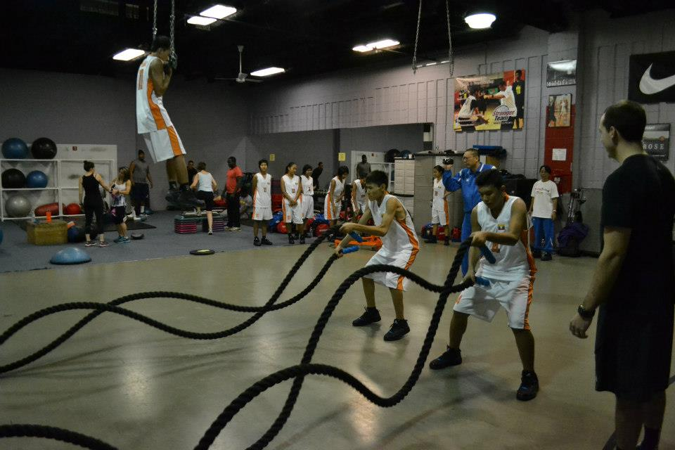 Participants work with expert basketball skills coach Stan Brudish on dribbling techniques.