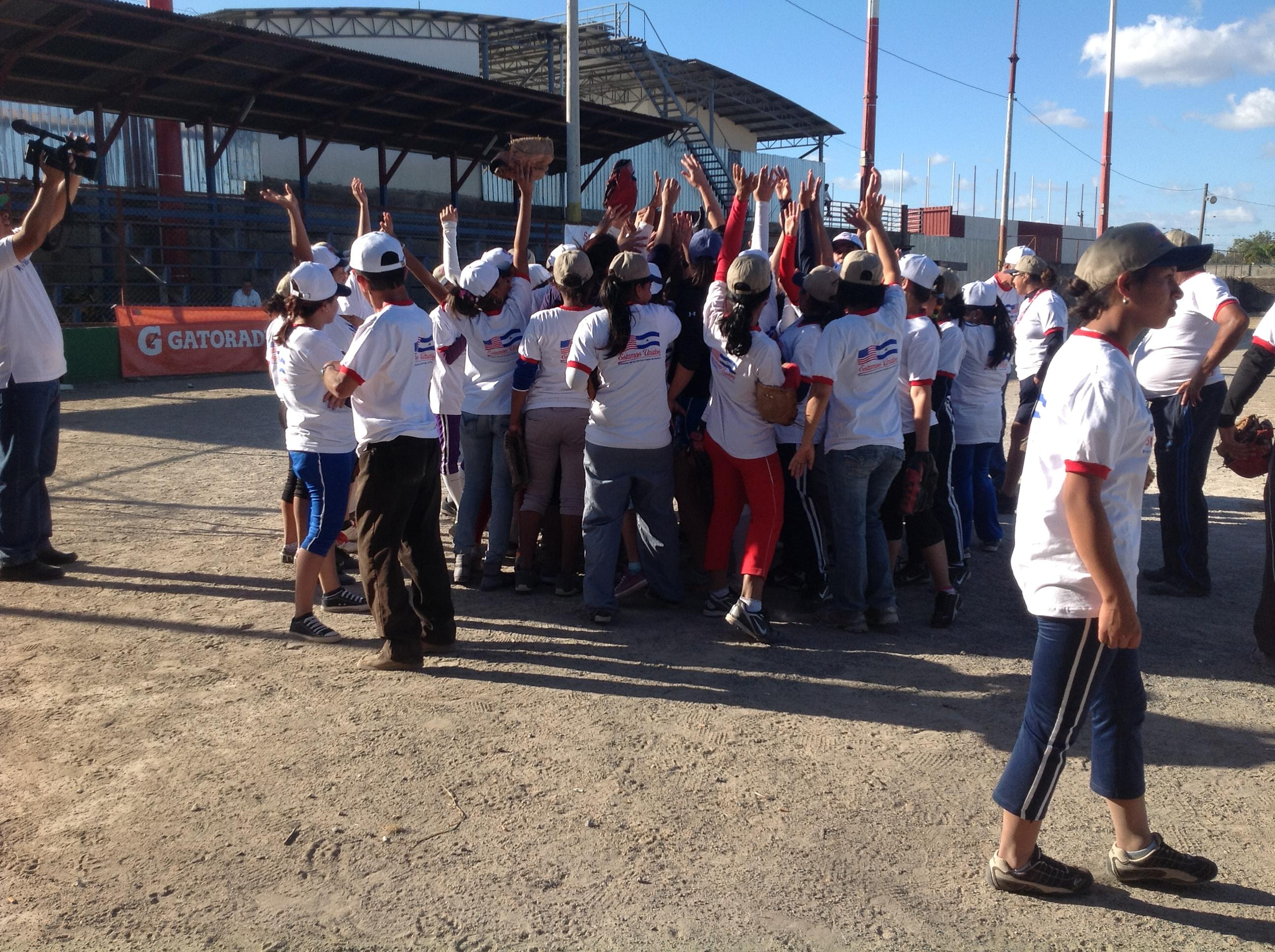 After an invigorating game, Nicaraguan players celebrate the sport of softball with a group cheer.