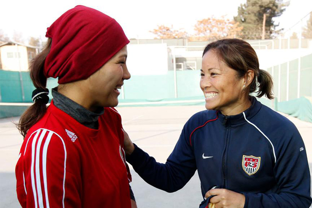 Zahra Mahmoudi, captain of the Afghan Women's National Soccer Team, with Sports Envoy Lorrie Fair.