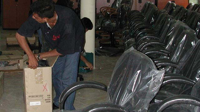 Iraq Museum staff assembles new office furniture supplied by the Department of State, July 2003