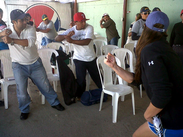 Softball coaches in Nicaragua practice batting stances and learn new coaching techniques from Jess Mendoza.