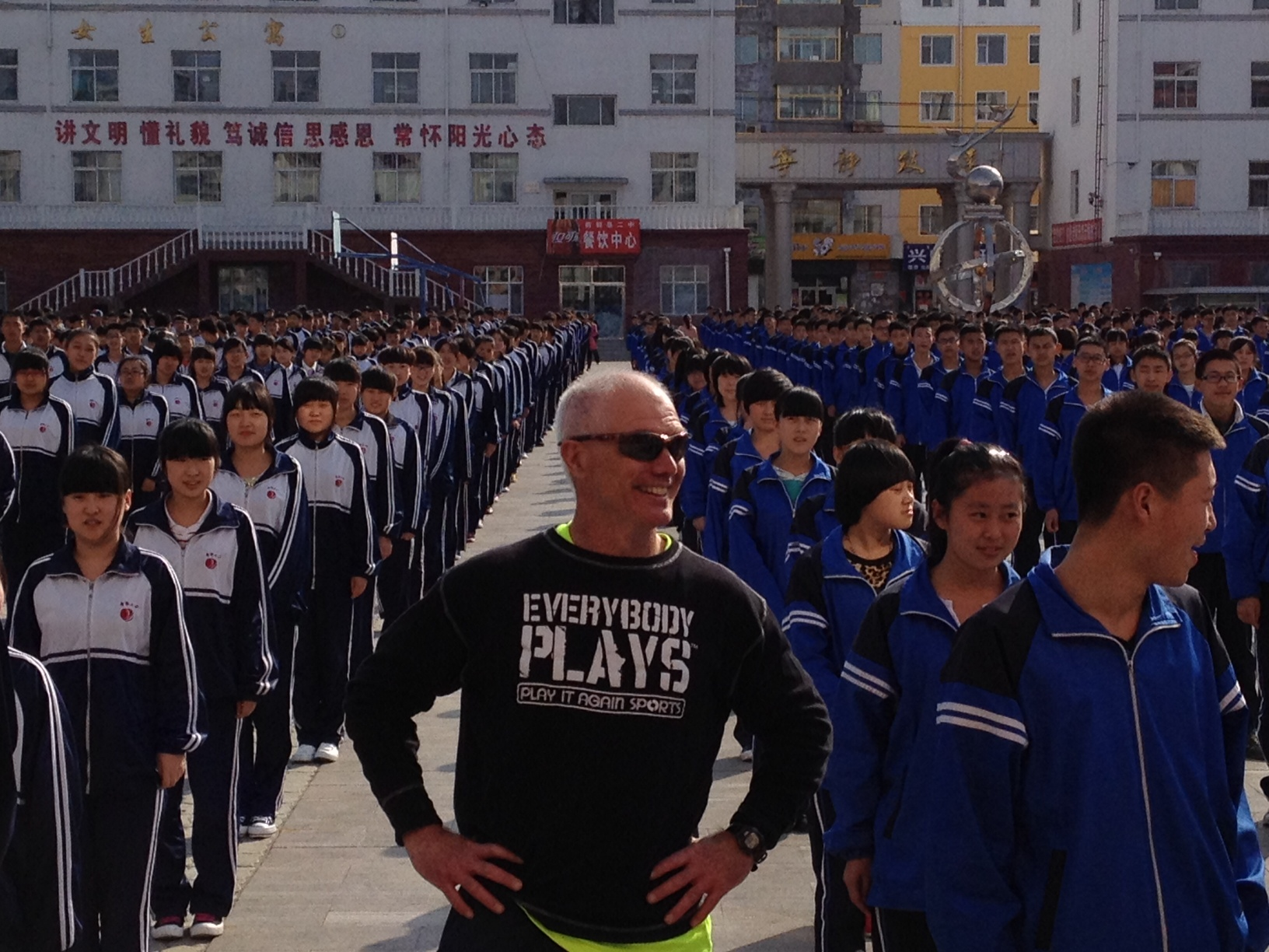 An American participant leads the Chinese youth in some exercise activities.