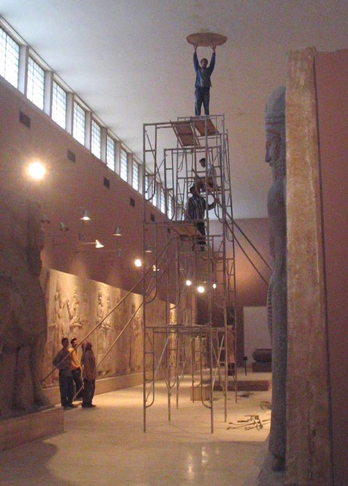 Contractors repairing the roof in the Assyrian Gallery under the Department of State infrastructure improvements initiative, February 2004