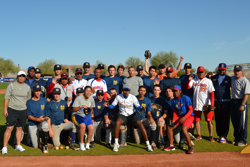 The Dominican Republic and Venezuelan visitors gather with their MLB counterparts after a full day out on the field.
