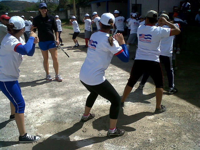 Teenage softball players from Nicaragua work on batting stances after receiving key instructions from Jess Mendoza.