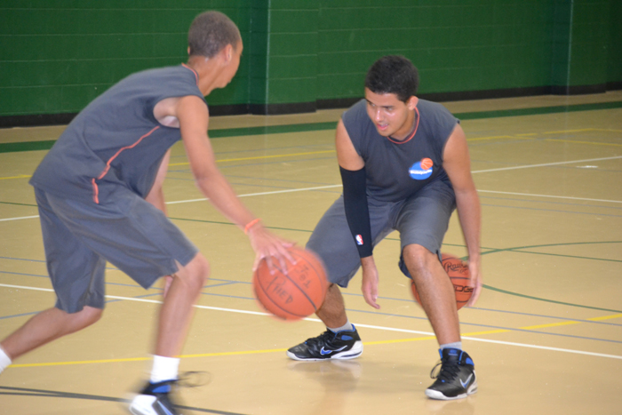The Brazilian youth basketball players practice dribbling while warming up for a full-day of basketball clinics.