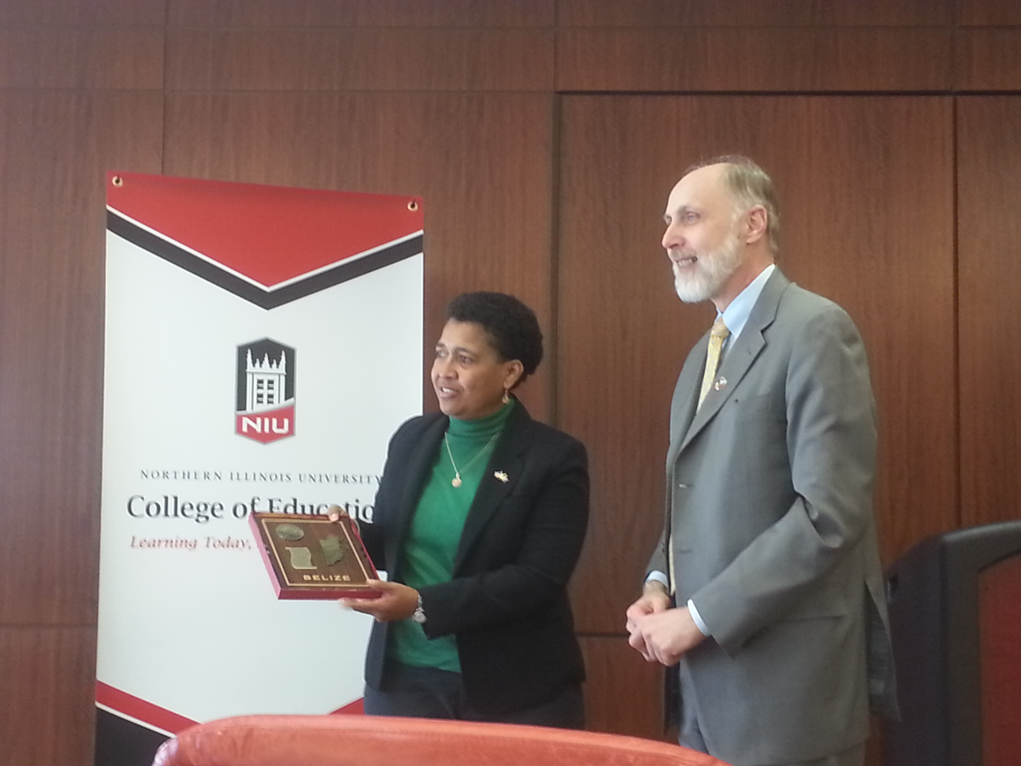 Delegate Clara Cueller presenting a gift to President Baker
