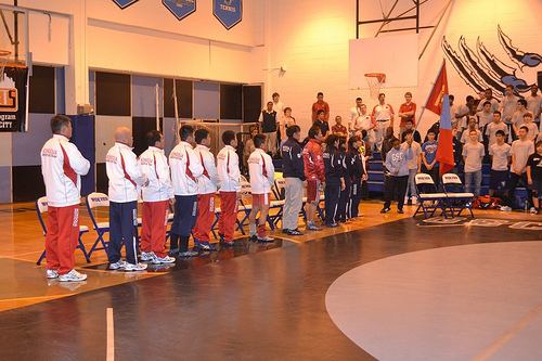 The Mongolian wrestling delegation lines up before a dual in New York.