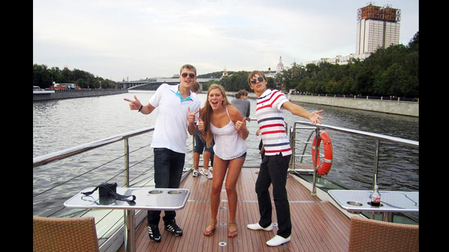The American and Russian swimmers take a boat tour of Moscow, Russia.