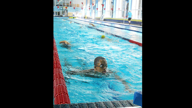 An American swimmer perfects his stroke by the end of the program.