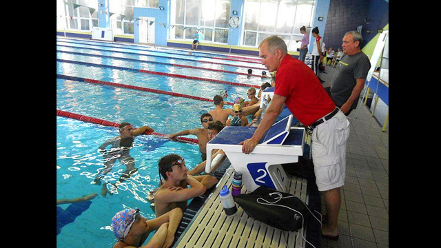 Coach Alex, originally from Belarus, coaches both the American swimmers and the Russian swimmers.