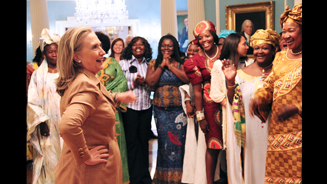 The 2012 AWEP women give Former Secretary Clinton a rousing ovation as she enters the Treaty Room at the Department of State.