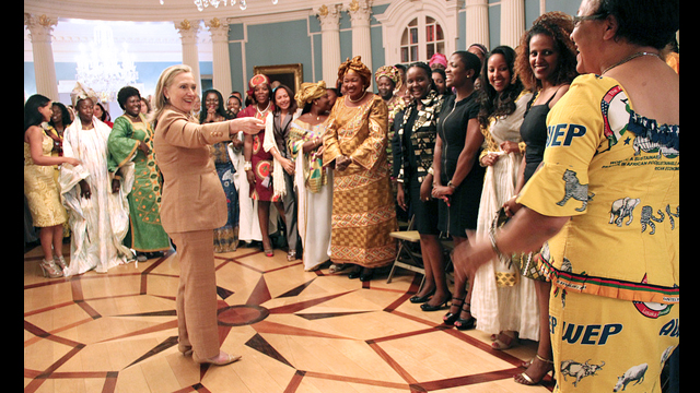 Former Secretary Clinton acknowledges the yellow AWEP dress of one of the participants.