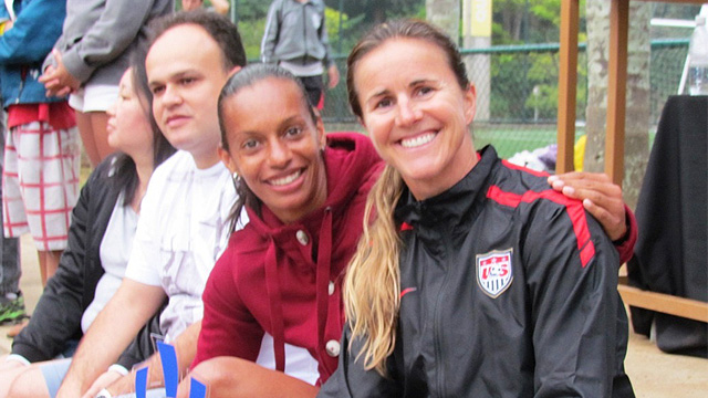 Brandi Chastain poses with Rosana dos Santos Augusto at a Soccer Festival in celebration of the positive things that come with participation in sports.