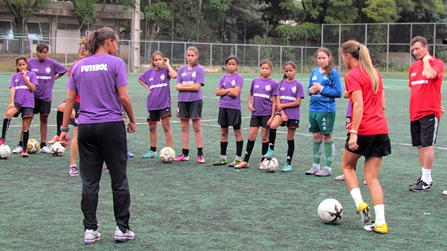 Players on a girls under-13 team take part in a clinic with the envoys, followed by a Q&A session on the differences and similarities in American and Brazilian sports programs.