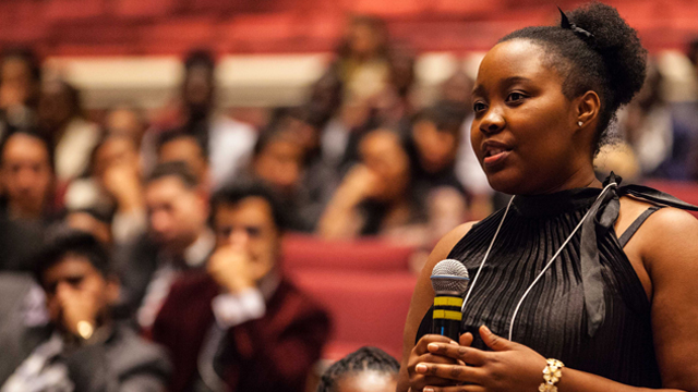 Girl holding a microphone at a conference