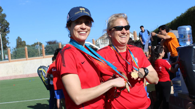 Kate and Linda displaying their Olympic gold medals.