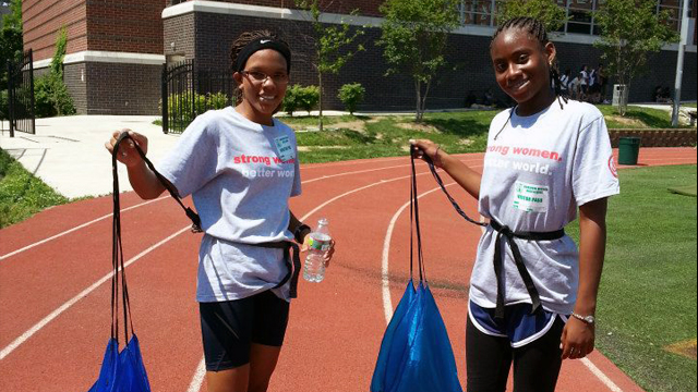 Two of the Colombian sports visitors enjoy their first training with parachutes at a local track practice in D.C.