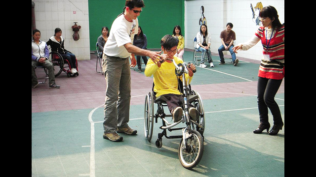 Guangzhou English Training Center (GETCH) students lead an adaptive cycling session in China.