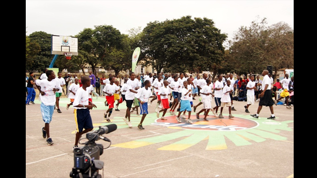 Young Congolese athletes warm up for their basketball clinic.
