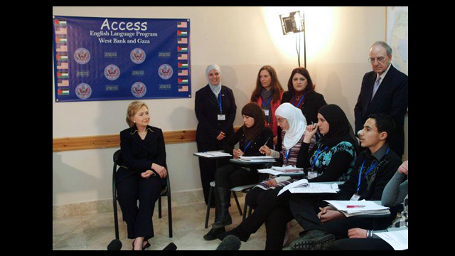 Secretary of State, Hillary Clinton, with students in an English language school in Ramallah, Palestine.