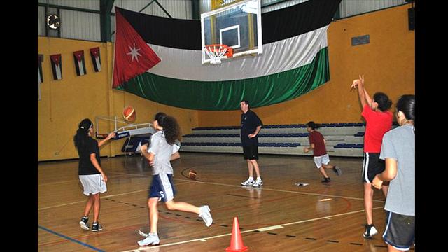 Marty Conlon coaches young Jordanians during their basketball drills.