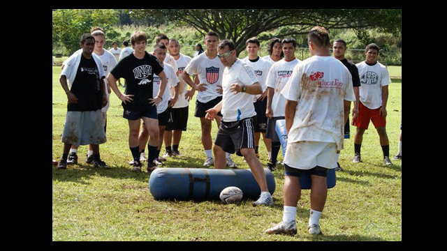 Wesley Clarke of New Zealand Rugby Union teaches rugby drills to youth in Hawaii.