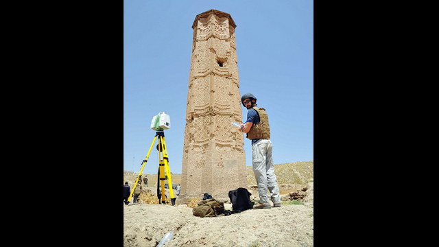 Paul Davidson, an architect with HABS, records field notes in front of the Mas'ud III tower