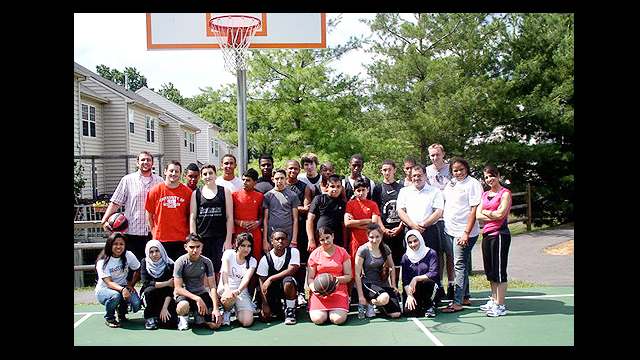 The group poses with some American basketball players.