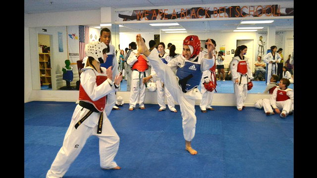 The taekwondo athletes demonstrate good kicking form in every session.